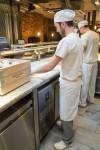 Chefs prepare pizza at Franco Manca Covent Garden