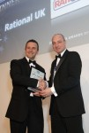 Lee Norton of Rational, left, receives the Heavy Equipment Supplier Award from Jack Sharkey of CEDA